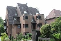 Einzigartige und gehobene Maisonette-Eigentumswohnung mit Wintergarten, Kamin, Garten und Tiefgarage