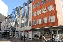 Zwei vollvermietete, attraktive Wohn- und Geschäftshauser mit Balkonen und TG - Plätzen in GE-City