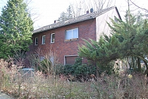 Kernsanierungsbedürftiges Einfamilienhaus mit Einliegerwohnung in herausragend guter Lage